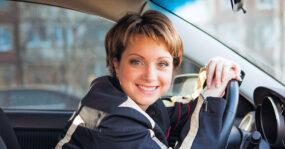 lady leaning on steering wheel