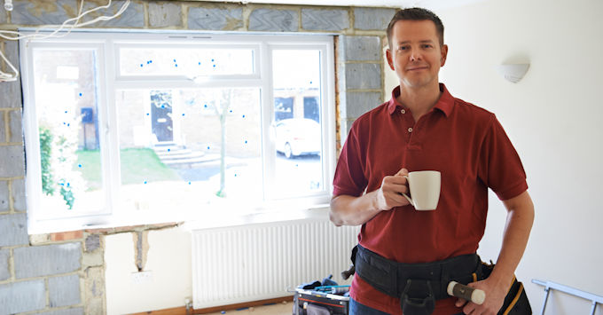 Guy holding coffee cup in construction